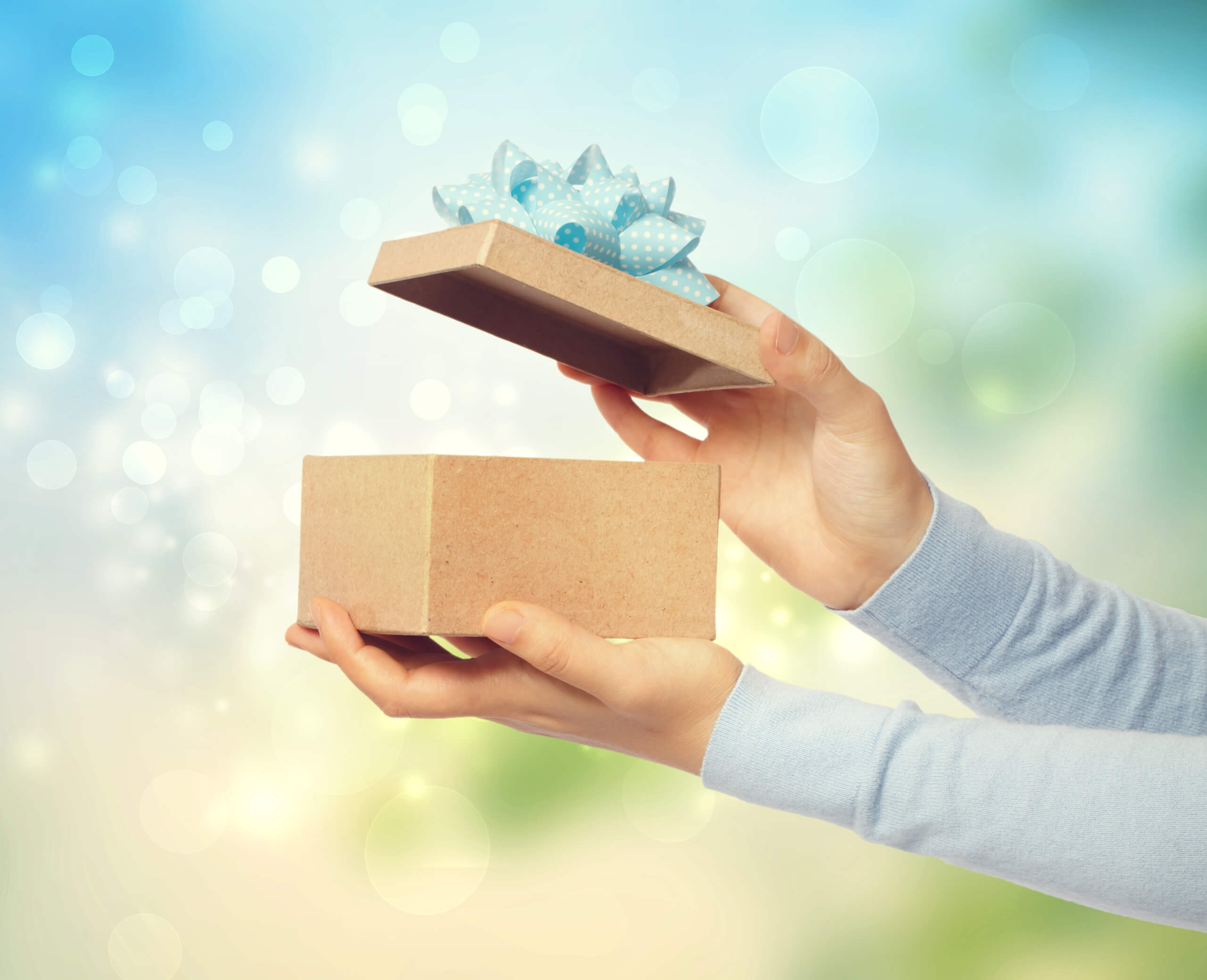 Gedanken Stopp graphicstock woman opening and presenting gift box on bright background SKqAtpyGOb