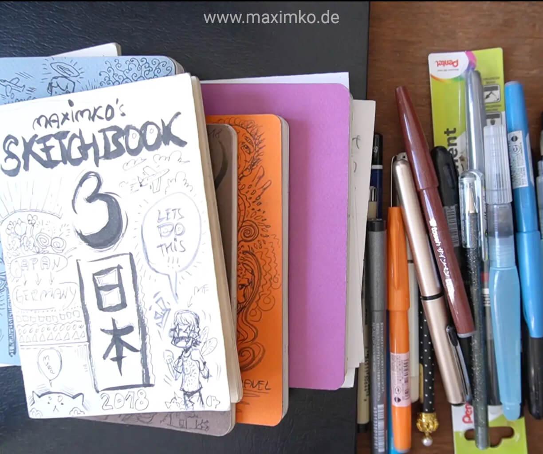 zeichnen im skizzenbuch zeichenmaterialien stifte buch heft mit maxim simonenko