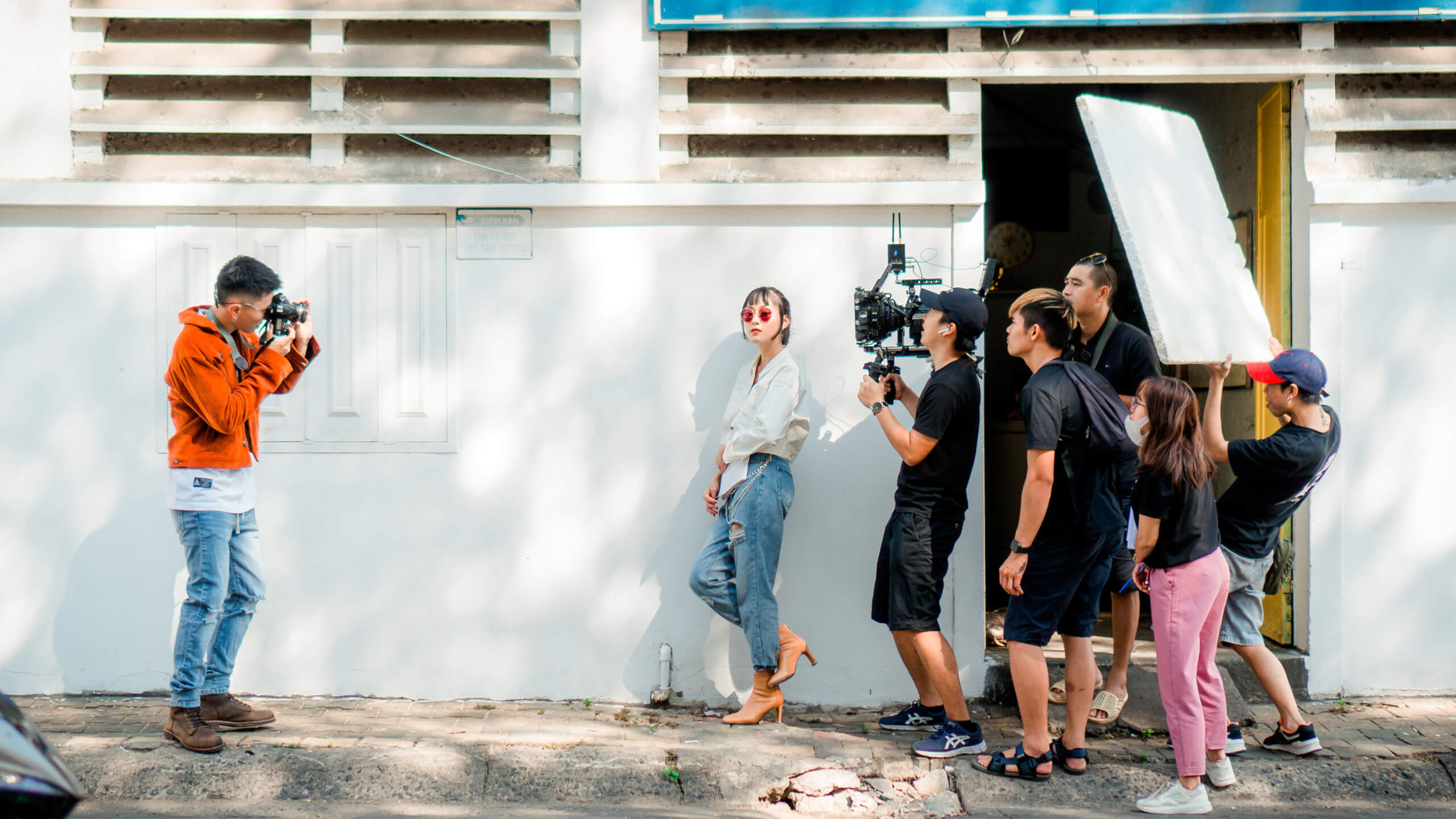 tv dialogue: film crew shooting a scene with an actor on a city street