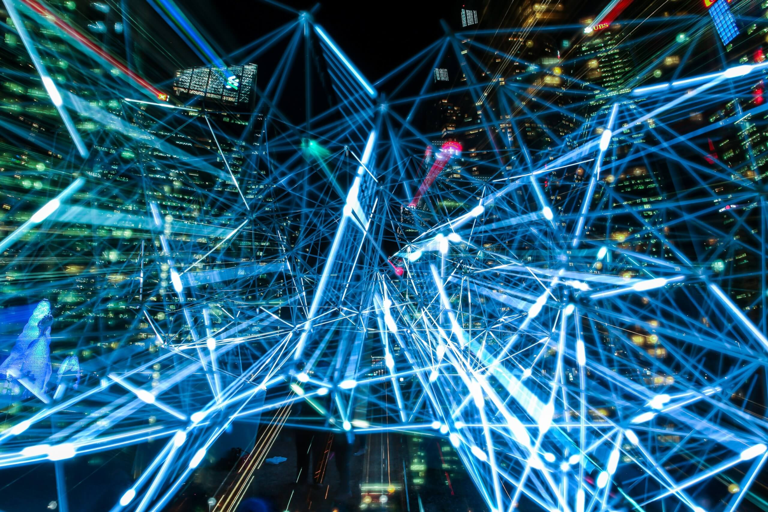 Neural machine translation: A complicated structure in a night time cityscape mimics the way biological neurouns signal one another in the brain